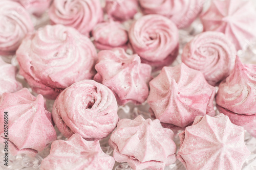 Home made pale pink marshmallow different shapes and patterns on a glass plate. © sveta