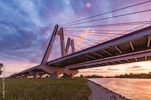 Spoed Foto op Canvas Brug Cable stayed bridge over Vistula river, Krakow, Poland, beautiful colorful sunset