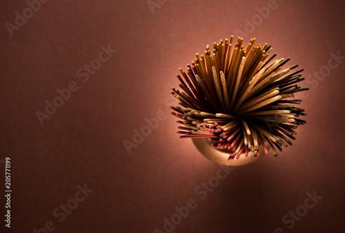 Incense aromatic sticks in a copper pot, top view Canvas-taulu