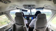 Pilots In Cockpit During Fligh...