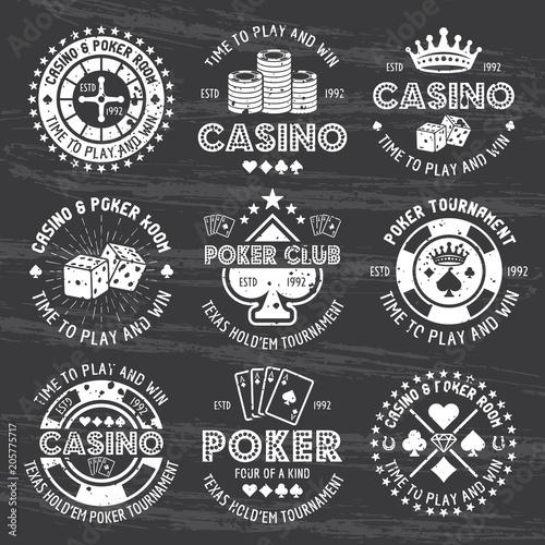 Poker and casino white gambling emblems on dark плакат