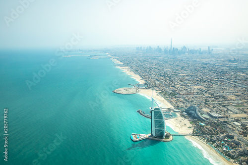 Aerial view of Dubai coast line on a beautiful sunny day.
