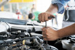 Check the condition of the car engine, Man repair the car engine