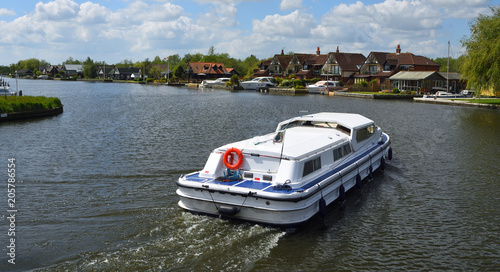 Broads Cruiser on the river Bure at Horning.