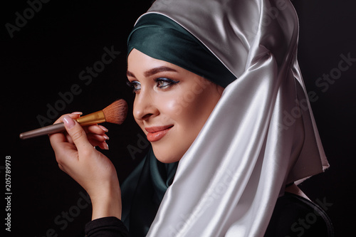 Obraz na płótnie close-up portrait of charming Muslim woman wearing makeup