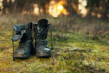Close Up Of Vintage Pair Of Walking Boots On Boulder Grassland Background.