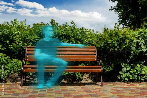 concept, virtual life. Hologram guy sitting in the park on a bench