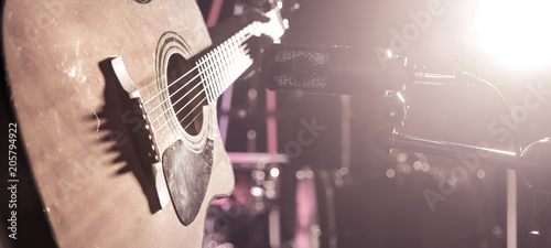 The Studio microphone records an acoustic guitar close-up. Beautiful blurred background of colored lanterns. - 205794922