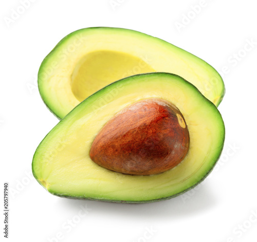 Valokuva two halves of cut ripe avocado isolated on white background