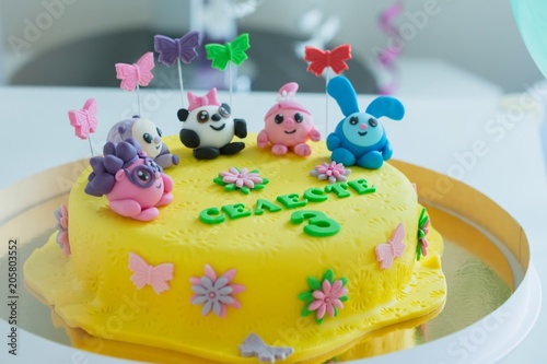 Child Colorful Birthday Cake Decorated With Little Cartoon Characters On The Top Buy This Stock Photo And Explore Similar Images At Adobe Stock Adobe Stock