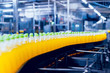 Conveyor with bottles for juice or water. Beverages factory equipments
