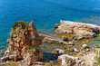Beautiful rocky Kanoni beach of Kassiopi in Corfu, Greece