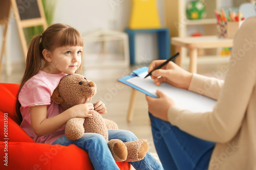 Cute little girl at child psychologist's office