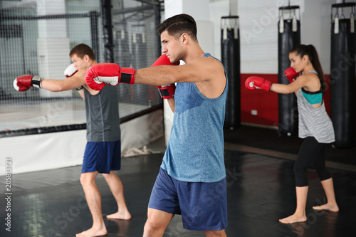 Fotomural Young boxers warming up before training in gym