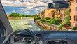 Car windshield with view of Adige River in Verona, Italy