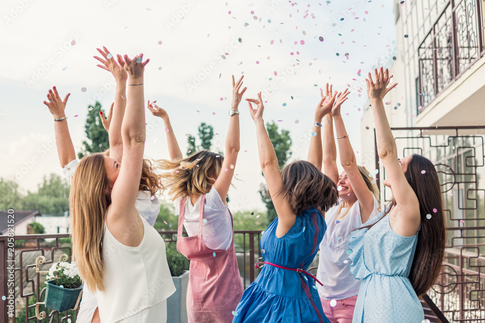 Fototapety, obrazy: Girls Party. Beautiful Women Friends on the balcony Having Fun At Bachelorette Party. They are dancing in confetti with hands up