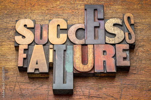 Photo  success and failure - word abstract in wood type