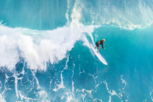 Surfer On The Crest Of The Wav...
