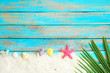 Summer background with starfish, shells, and coral on blue wooden background. Summer concept, Vintage retro styles