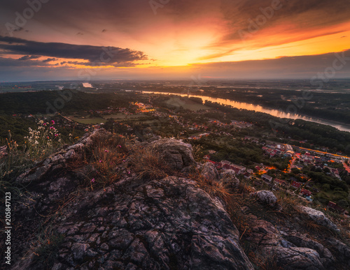 Foto op Plexiglas Diepbruine View of Small City of Hainburg an der Donau with Danube River as Seen from Rocky Hundsheimer Hill at Beautiful Sunset