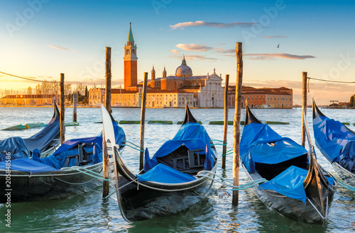 Spoed Foto op Canvas Venetie Venice sunrise. Gondolas by Saint Mark square with San Giorgio di Maggiore church in Venice, Italy,