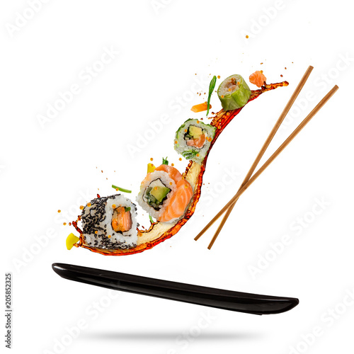 Poster Sushi bar Flying sushi pieces on white background
