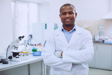 I Feel Great. Happy Successful Researcher Wearing A Uniform And Standing In The Lab