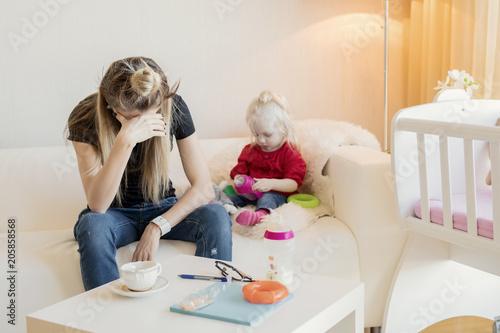 Valokuva  Mom exhausted by babysitting