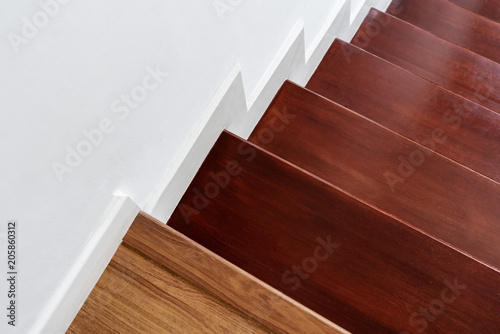 Tuinposter Trappen Hardwood stair steps and white wall, interior stairs material and home design