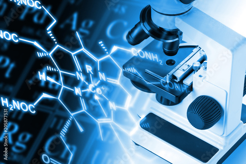 Photo  Research microscope with molecule structural formula and periodic table of the e