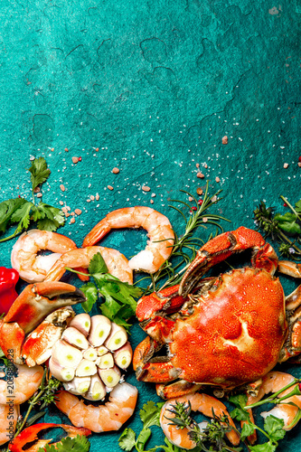 Fresh raw seafood - shrimps and crabs with herbs and spices on dark gray background Canvas-taulu