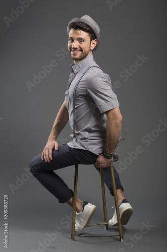 Fototapety, obrazy: Studio portrait of a handsome young man wearing old fashioned retro clothing and posing on grey background