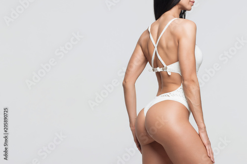 Fototapeta Crop woman in nice swimwear