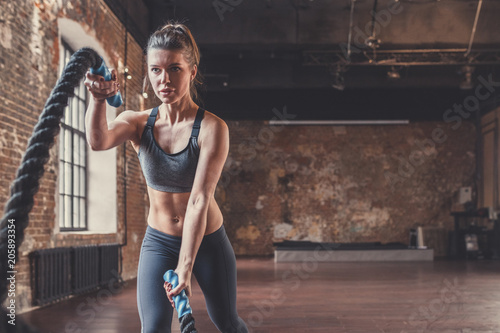 Fototapety, obrazy: Young sporty woman with a rope