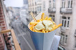 canvas print picture - Belgian fries with mayonnaise on blurred Brussels street