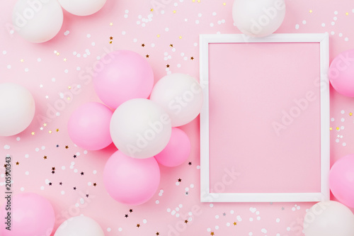 Obraz Birthday mockup with frame, pastel balloons and confetti on pink table top view. Flat lay composition. - fototapety do salonu