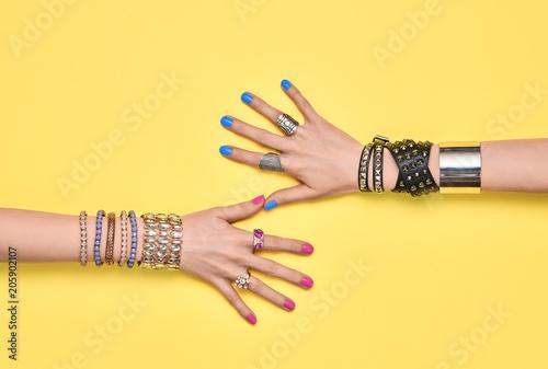fototapeta na szkło Fashion. Female hand, Trendy Jewelry. Friendship
