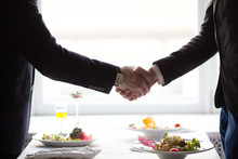 Businessman Shaking Hands Before Business Lunch. Business Lunch Concept.