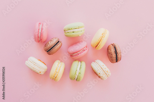 Keuken foto achterwand Macarons stylish colorful macaroons on trendy pink paper, flat lay. space for text. modern food photography concept. tasty pink, yellow, green, white, brown macarons. yummy background