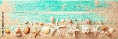 Beach Accessories With Seashells On Wooden Board. Summer Holidays
