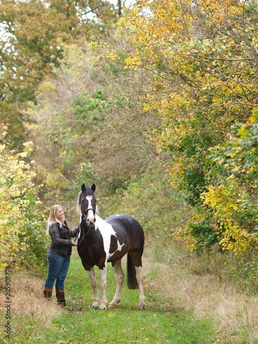 Poster Equitation Girl Standing With Horse