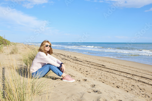 woman relaxing at the beach buy this stock photo and explore