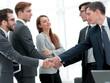 leaders of business teams shake hands