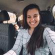 car travel concept. woman driver, passenger seeping at backseats