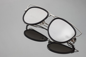 sunglasses with mirror glasses on grey background