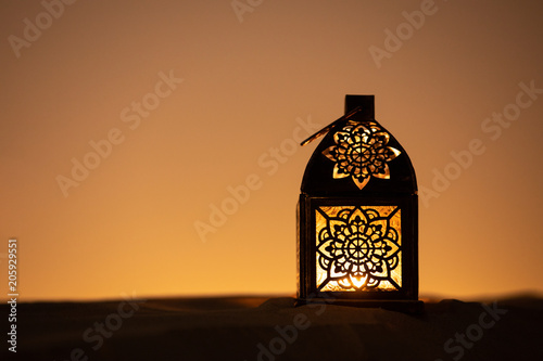 Traditional ornamental arabic lantern in desert.