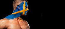 Soccer Or Football Fan With Bodyart On Face - Flag Of Sverige.