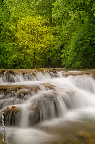 Poster Watervallen French landscape - Jura. Waterfall in the Jura mountains after heavy rain.