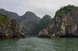 Beautiful limestone mountain scenery at Ha Long Bay, North Vietnam. Cloudy winter weather