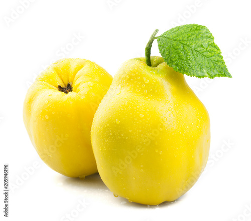 Ripe juicy quince with leaf isolated